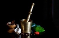 A pestle and mortar Imam brass dasta