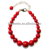 Imitated round red coral bracelet with gold plated chain