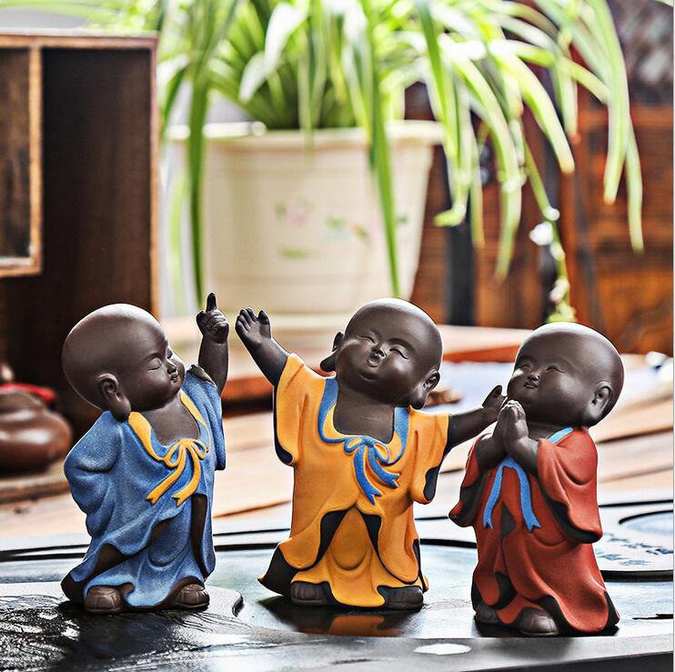Factory new product creative three models small ceramic monk crafts for wholesale