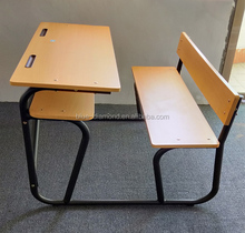 Attached wooden double student desk and chair