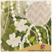 Textile alibaba fabric 100 polyester swiss white embroidery 3d lace fabric beads bridal