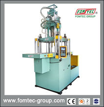 DOUBLE SLIDING INJECTION MOLDING MACHINE