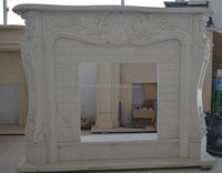 white hand carved marble fireplace mantel