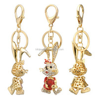 promotional and lovely metal alloy nickle free crystal rhinestone rabbit holds a candy animal keychains pendant jewelry for girl