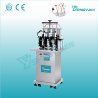 Factory - China high quality 4 heads vaccum perfume glass bottles filling machine