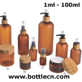 cosmetic frosted amber PET bottle with pump bamboo cap