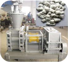 Briquette machine for mineral powder