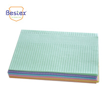 Two layers tissue paper disposable dental bib for surgical use