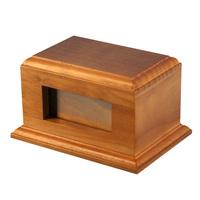 Carved wooden cremation urns for pets