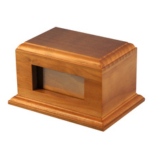 Carved wooden cremation urns for pets