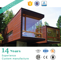 prefabricated steel frame modular house with dark wooden exterior decoration
