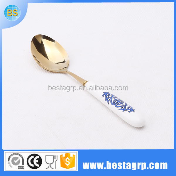 Sterling silver salt spoons, caramic handle ice cream spoon, gold tea spoon