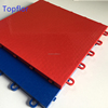 Interlocking plastic tile for indoor sports flooring