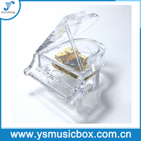 clear acrylic piano shape musical box with golden musical movement