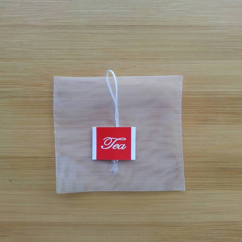 empty pyramid nylon tea bags with string and tag
