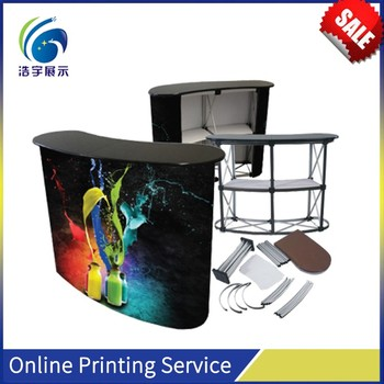 Strong Plastic ABS Main Body with a Wooden Header Board for Theme Promotion Shop Counter Table Design