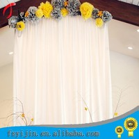 fancy and elegant pipe and drape wedding backdrop