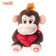 Custom big mouth plush brown sitting monkey with a red heart