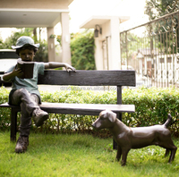 sitting on a bench read book boy bronze sculpture with a dog