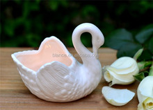 ceramic swan candle holder in swan candle container