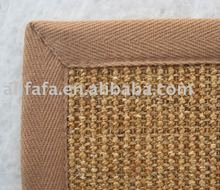 natural sisal area rug with beige cotton bind edge,