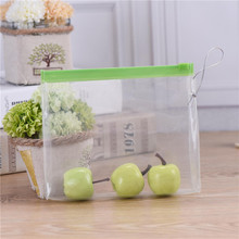 Transparent clear plastic standup zipper pvc cosmetics bag with tag