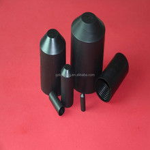 Heat shrinkable cable end caps with adhesive coating