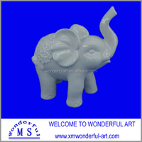cute and good looking white porcelain elephant figurine