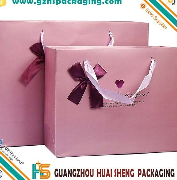 Customized logo silver hot-stamping logo luxury paper gift bags wholesale,paper bag printing with silk handle and bowknot