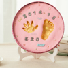 families making clay handprint for babies,kids ,pets
