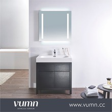 Fashionable black vanity with 2 doors, framed mirror hand carved bathroom vanity