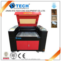 jinan co2 high quality laser engraving cutting machine for rubber stent leather fabric acrylic shapes garments cloth