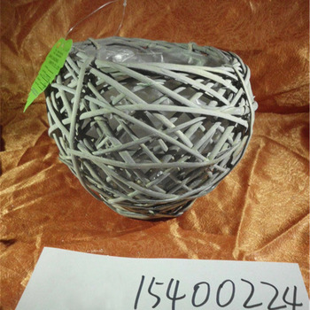 Small grey lighted outdoor wicker flower pot with plastic liner