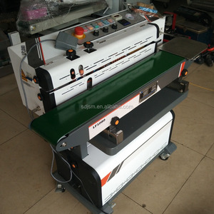 Vertical vacuum packaging band continuous sealing machine with gas flush