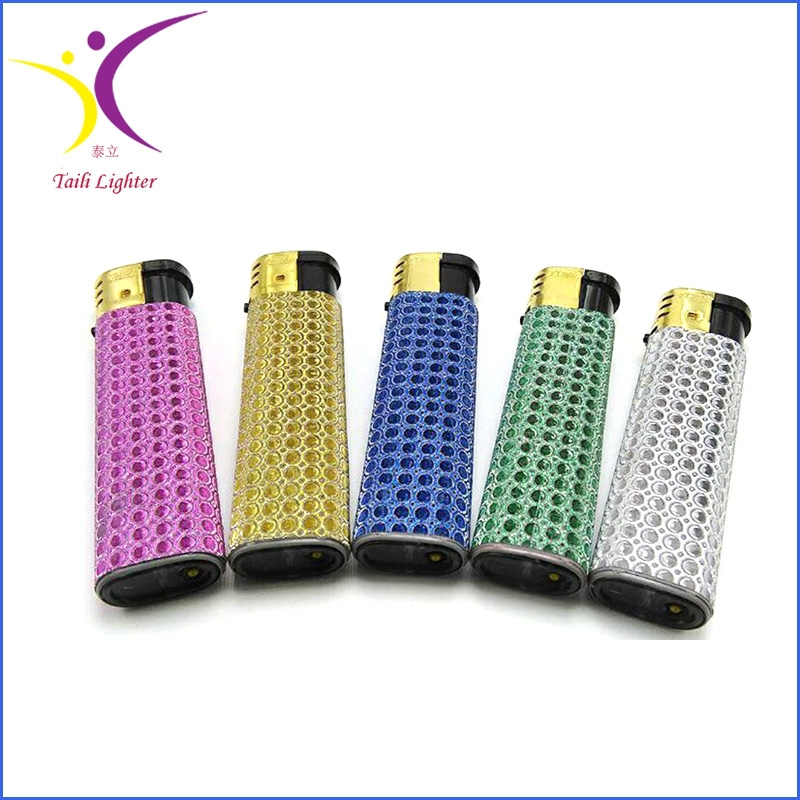 Silver match lighters colored with golden cap star lighter