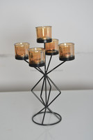 12A008 Black metal and 5 amber glasses candle holder