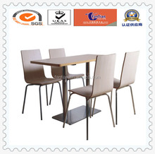 Panel wooden dining table with four wooden seat