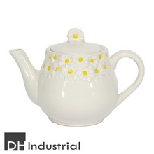 ceramic white glazed teapot with a pretty three dimensial daisy pattern lining the top