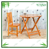 folded bamboo sets with table and chair in garden