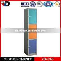 Staff and worker clothes metal cabinets in a locker room with bench with key lock