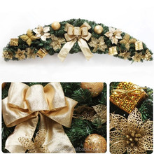 Christmas Decorative wreath with one gold ribbon butterfly and flower