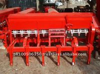 Planter with fertilizer attachment
