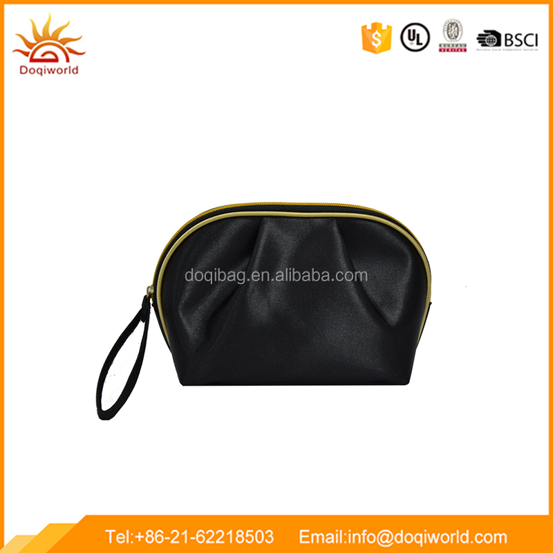 black satin material small cosmetic bag with golden color piping