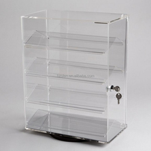 Acrylic Counter Top Revolving Display Case with lock 4 angled shelves displaying jewelry