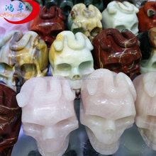 Natural quartz crystal skull with the snake in the head carved for decoration