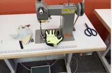 Green color reinforced palm leather gloves sewing machine
