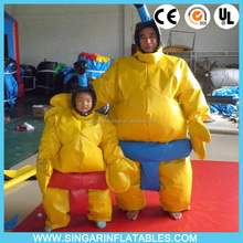 Inflatable fighting sumo wearing suits for hire