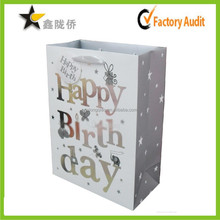 Hot China wholesale fine cheap personalized UV spot ribbon tie foldable birthday cake bag gift paper bag