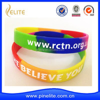 Wholesale OEM cheap silicon bracelets with ink-filled logo and scented band
