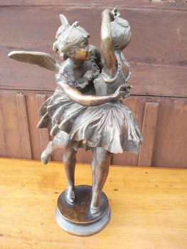 A Fairy Embracing A Girl